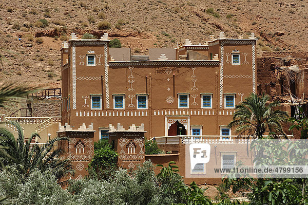 Typical mud house  Kasbah  residential castle of the Berbers  decorated with traditional ornaments and tribal signage  near Tinerhir  High Atlas  Morocco  Africa