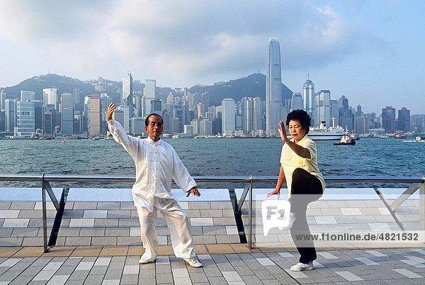 people practising Tai Chi Chuan along the Victoria Harbour waterfront in Tsim Sha Tsui  Kowloon Peninsula  Hong-Kong  People´s Republic of China  Asia