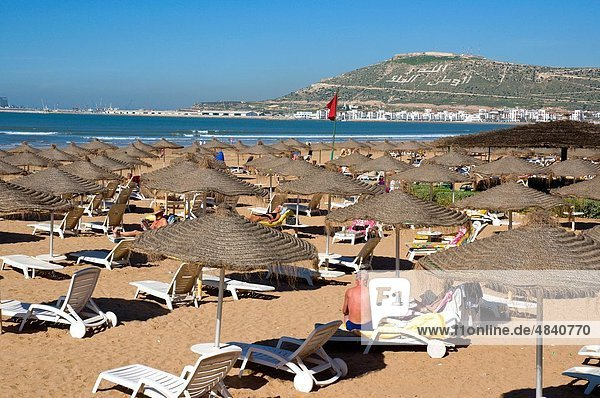 Beach with Kasbah hilltop in background Agadir the Souss southern Morocco Africa