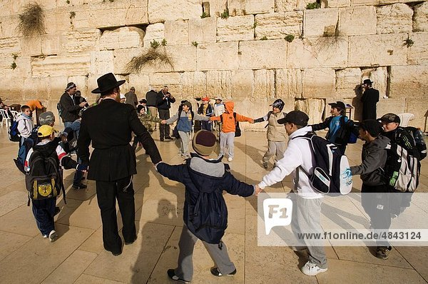 Group of children singing and dancing in Western Wall  Wailing Wall  Jerusalem  Israel  Middle East.