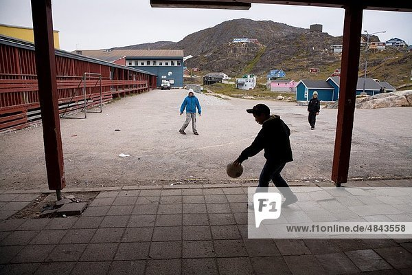 School boys playing soccer Qaqortoq Julianehåb  South Greenland