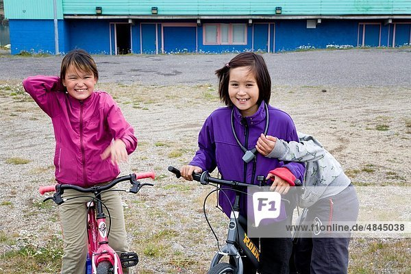Girls on bicycles  Narsaq  South Greenland