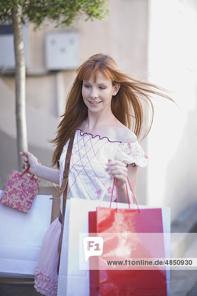 Woman carrying lots of shopping bags