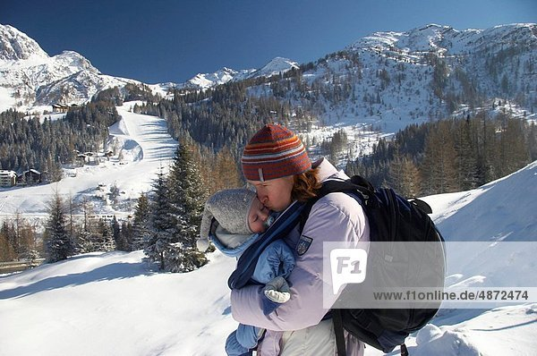 mother with baby / winter vacation