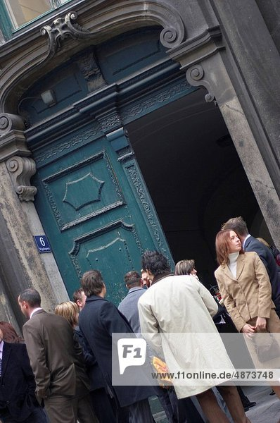 group of people waiting in front of a door