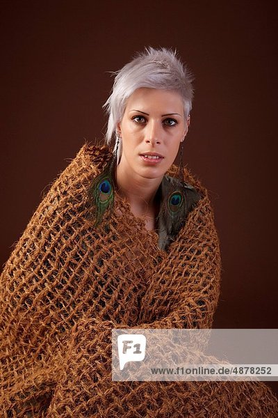 woman with brown wrap made of coconut fibre