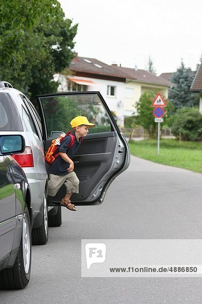 Child jumps out of a car
