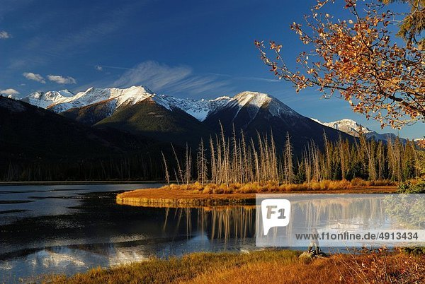 Photographer on First Vermilion Lake at sunrise in the Fall