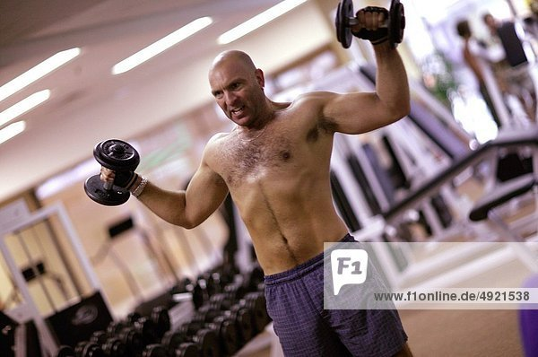 muscular man working out at a gym