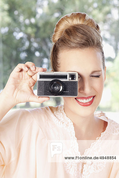 Woman taking a picture with a camera