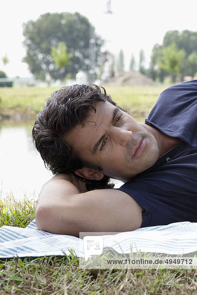 Close-up of a man lying on a blanket