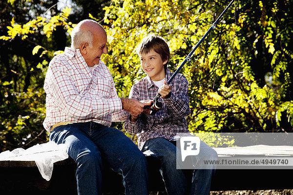 Junge - Person Großvater Fliegenfischen