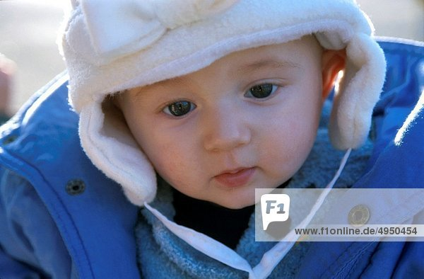 Baby girl wearing winter clothes outdoors  France