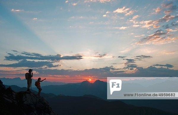 Austria  Salzburg Country  Altenmarkt-Zauchensee  Couple watching sunrise on mountains of Niedere Tauern
