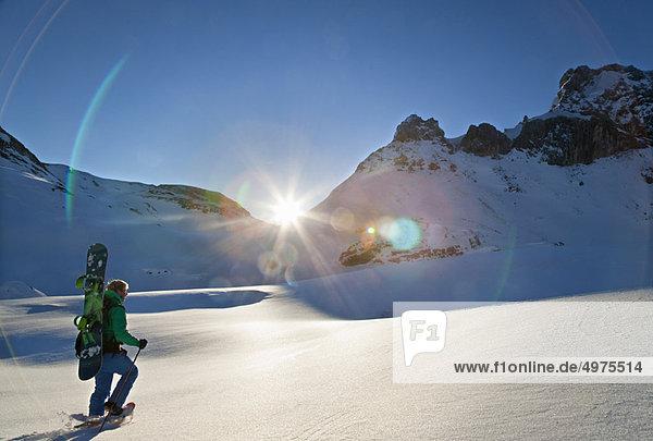 Schneeschuh  Snowboard  Morgendämmerung  wandern