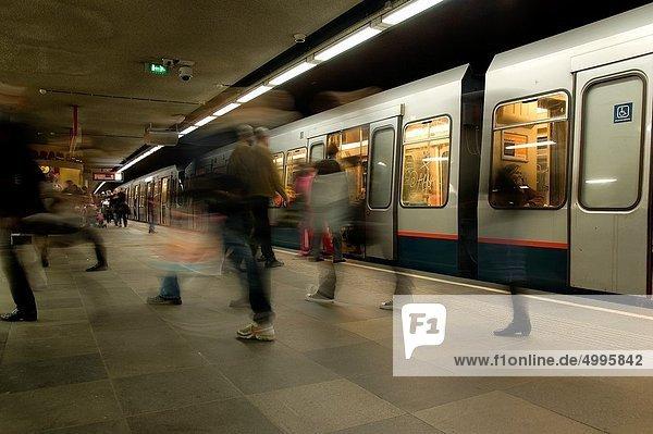 Rotterdam  Netherlands. Subway station platform with subway train and disembarking passengers. Rotterdam, Netherlands. Subway station platform with subway train and disembarking passengers.