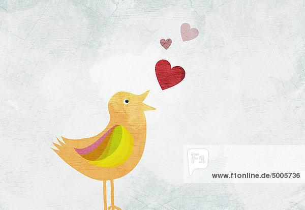 Ein Vogel zwitschert Liebesherzen