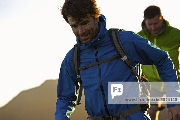 Men hiking together