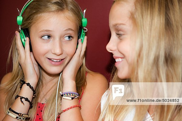 Twin girls listening to music