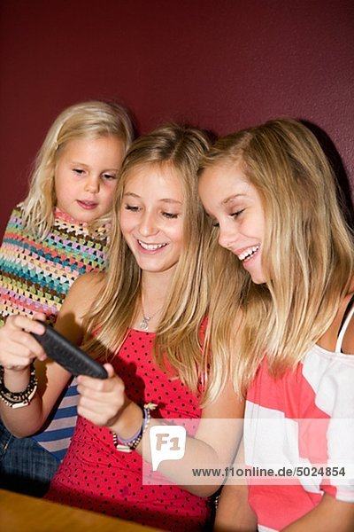 Three sisters playing video games