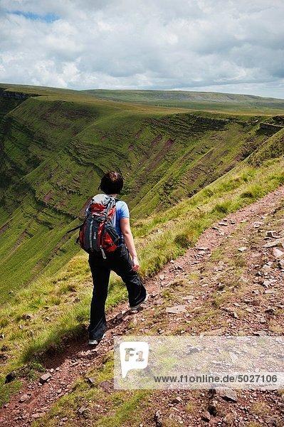 Female hiker on Bannu Sir Gaer ridge  Black Mountain  Brecon Beacons national park  Wales
