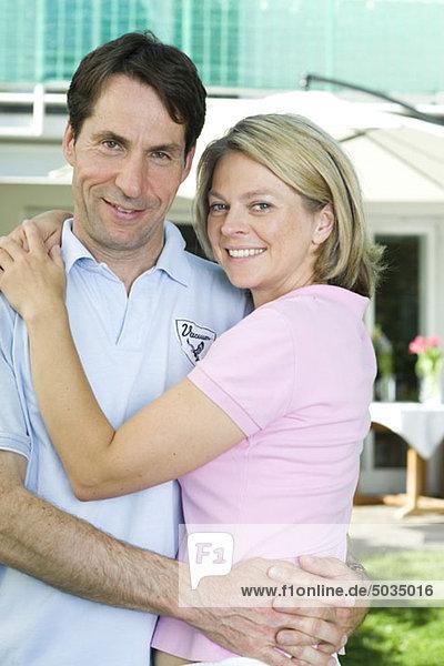 Happy couple in garden  Munich  Bavaria  Germany