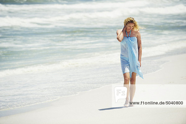 Mid adult woman walking on the beach
