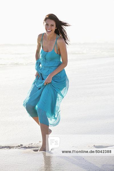 Beautiful laughing woman enjoying at beach