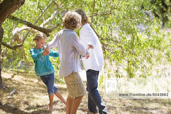 Little children playing outdoors