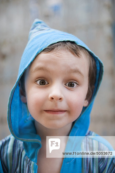 Little boy looking at camera with surprised expression  portrait