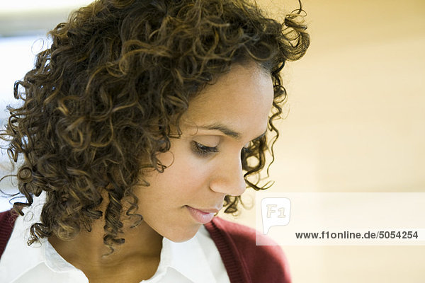 Woman looking down in thought  portrait