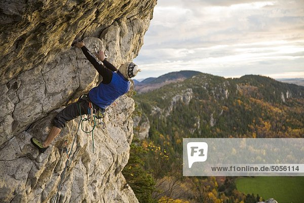 A young man climbs the popular route Moby Dick 5.11b  Kamouraska  QC