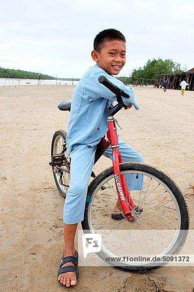 Fotografie  Strand  Junge - Person  fahren  7  sieben  alt  Jahr