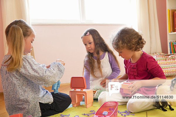 Girls playing with toys together