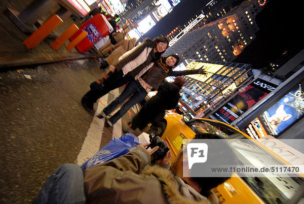 People taking pictures at Times Square  New York USA