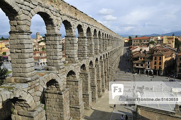 Europe  Spain  Castile and Leon  Segovia  View of cityscape through roman aqueduct