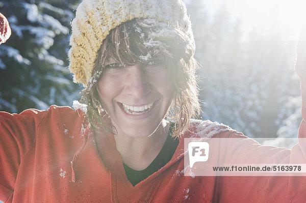 Austria  Salzburg Country  Flachau  Young woman having fun in snow