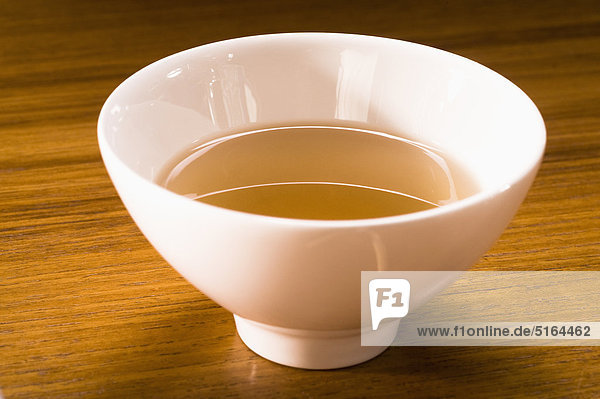 Germany  Bavaria  Munich  Close up of thai tea in bowl