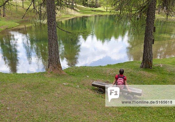 Woman resting at the Lago Scin near Cortina d'Ampezzo  Italy