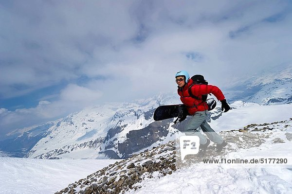 A snowboarder sprinting to be first to get the fresh lines