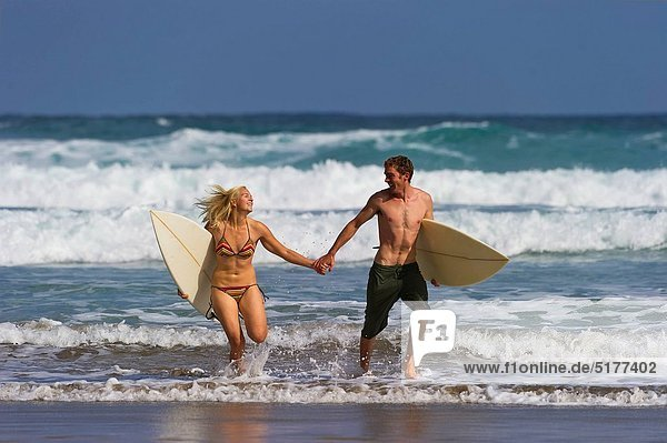 Two surfers enjoy a day at the beach