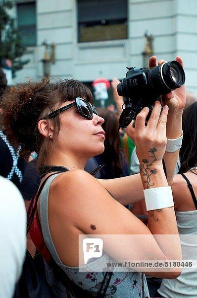 -Photographer in Demonstrations Indignants Movement 15M- 19 of Juny 2011  Barcelona (Spain).