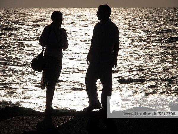 Beachgoers at sunset in Tel Aviv  Israel