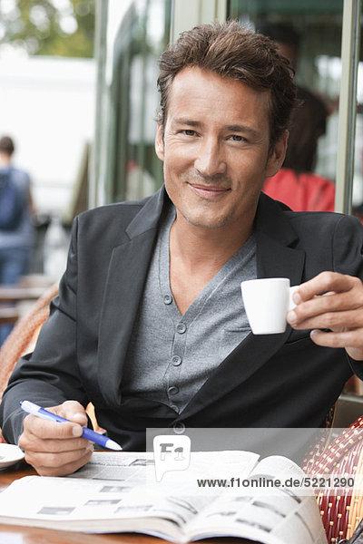Man drinking coffee in a restaurant  Paris  Ile-de-France  France