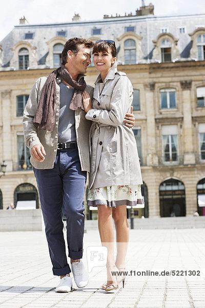 Couple walking on a street  Paris  Ile-de-France  France