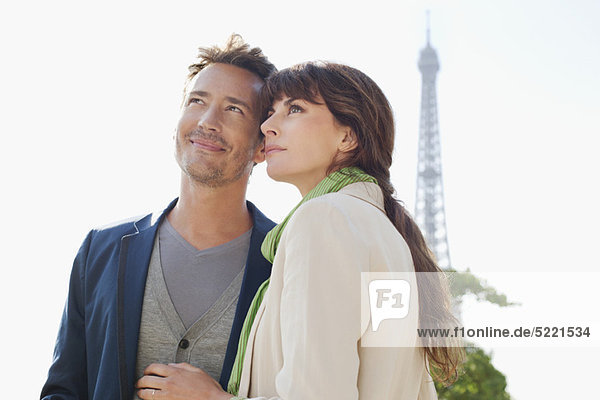 Happy couple with the Eiffel Tower in the background  Paris  Ile-de-France  France