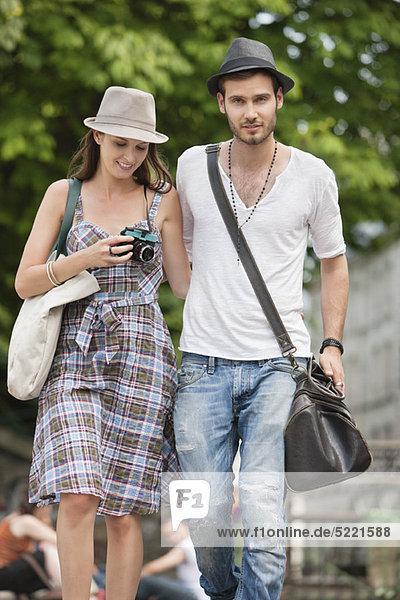 Couple walking on a road  Paris  Ile-de-France  France