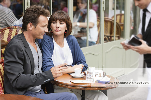Couple sitting in a restaurant  Paris  Ile-de-France  France