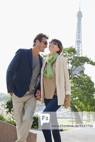Couple moving up steps with the Eiffel Tower in the background  Paris  Ile-de-France  France