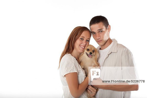 Young couple with pomeranian dog